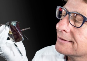 Dr Mark Keevers with one of the spectrum splitting, four-junction mini-modules developed at UNSW. Photo courtesy of University of New South Wales.